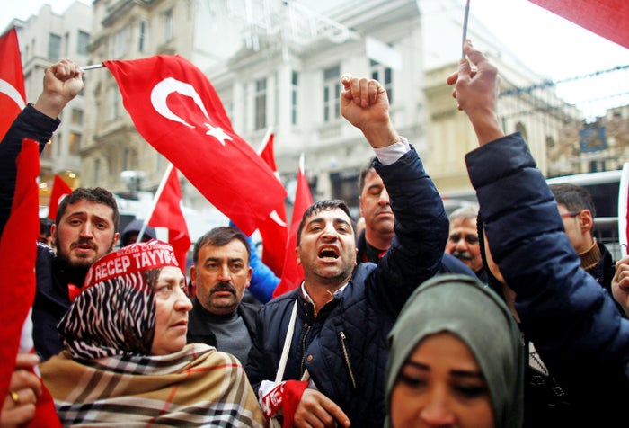 Protesters shout in front of the Dutch Consulate in Istanbul, Turkey.
