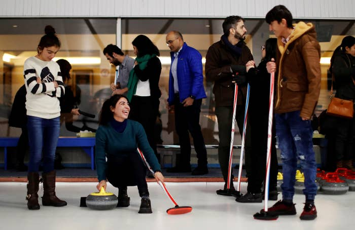 The refugees now calling Canada home come from all over: Syria, Afghanistan, Sri Lanka, and elsewhere. A big group of them grabbed their brooms at the Royal Canadian Curling Club in Toronto on Wednesday to try their hands at one of Canada's most iconic winter sports.