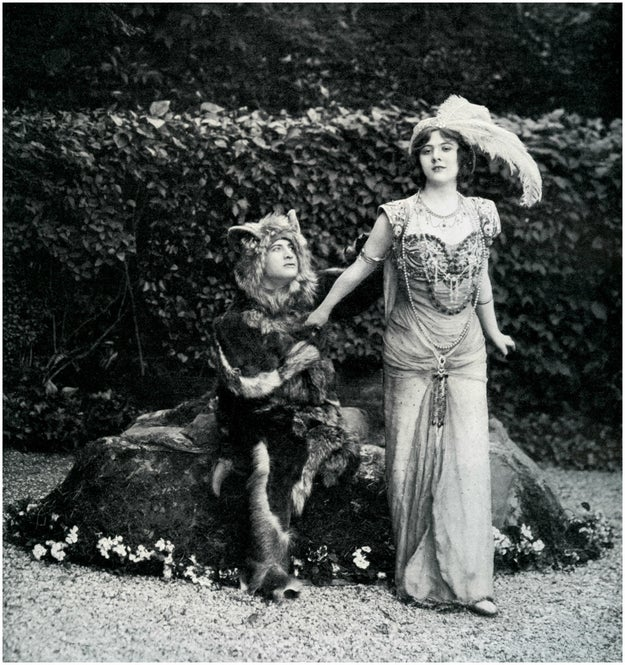 Moving on! In 1908, Le Theatre gave us this fabulous feathered Belle and the skunk-lion-man who kept her prisoner:
