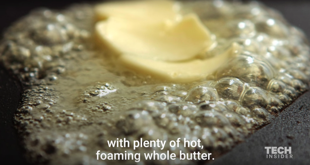 "Add a generous slice of butter to your hot pan and let it melt, or ""foam."""
