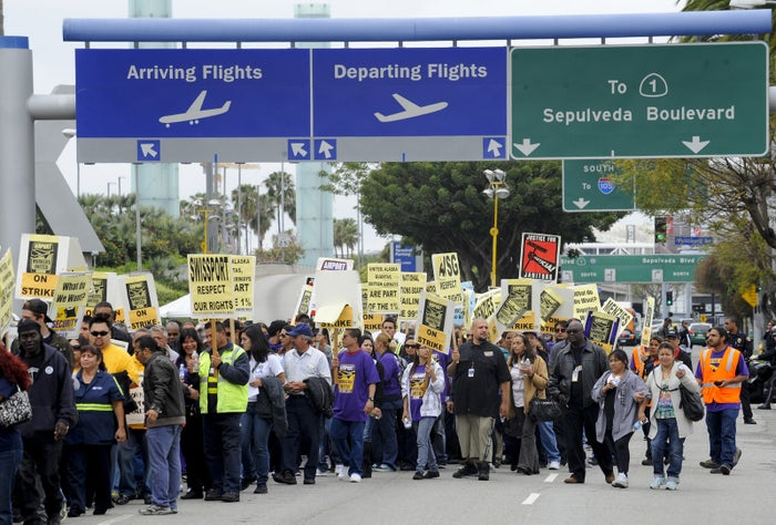 Members of SEIU United Service Workers West protest during May Day demonstrations at Los Angeles International Airport in 2012.