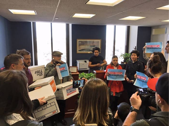 Activists lead a protest in Sen. Schumer's office on Capitol Hill.