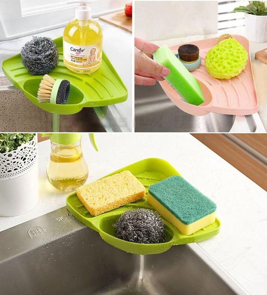 """Promising review: """"Perfect size for a medium-size bottle of dish soap, a large hand soap, and our sponge. Stays stuck to the sink with a suction cup. Regular-size sponge fits diagonally in the sponge holder, keeping it out of the way and clean while allowing it to dry."""" —Amazon CustomerGet it on Amazon for $10.99 (available in two colors)."""