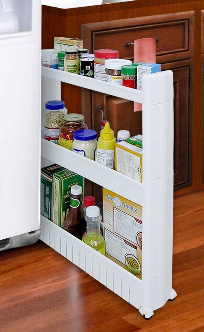 Space in the kitchen by adding shelves and glass canisters with seals - Utilize Every Nook And Cranny Of Your Home With A Slide Out Storage Tower