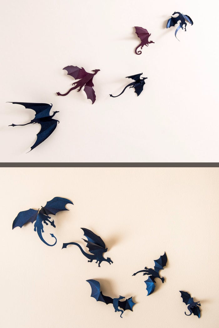 """Need to spice up your walls? No need to let the search drag on.Get a set of five or ten dragons from Hip & Clavicle on Etsy for $14+.You can customize colors (with the color chart provided) in the """"note to seller"""" box, or you can check out all of the default color options here!"""