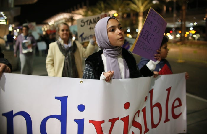 A Muslim woman marches at a March 6, 2017 rally in San Diego