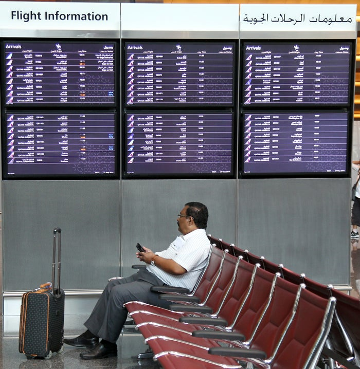 A passenger waits for a flight inside Hamad International Airport in Doha, Qatar.
