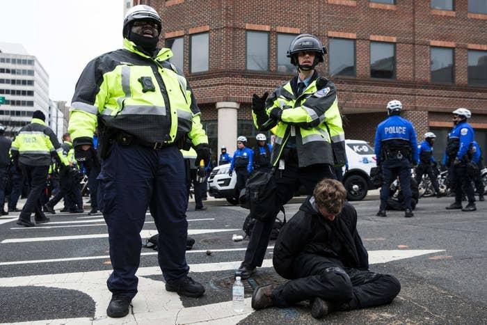Police detain a demonstrator on January 20, 2017