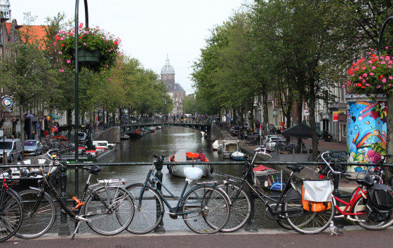 Biking along the Amstel River - Amsterdam, Netherlands