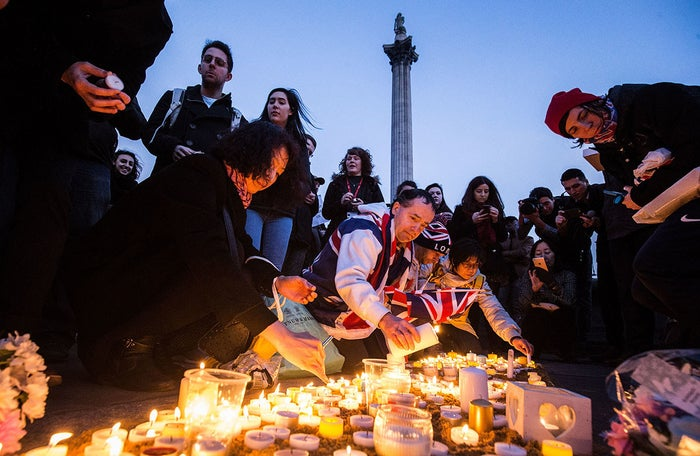 Mourners attend a vigil in London's Trafalgar Square for the victims of Wednesday's terrorist attack outside of the Palace of Westminster. ISIS has claimed responsibility for this attack by a man who plowed an SUV into pedestrians and then stabbed a police officer to death.