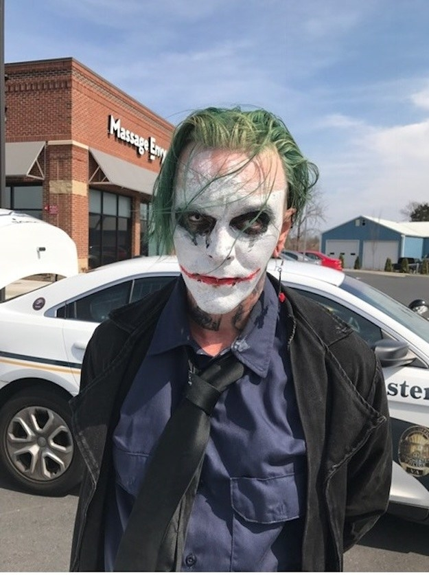 A man carrying a sword while dressed as the Batman villain the Joker was arrested Friday in Virginia, police said.