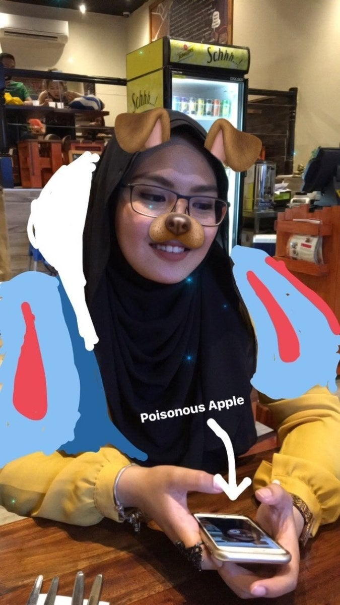 """Azman said Fouzi had just gotten a stylus for his phone, and that's how he decided to try it out.She thought his drawing of her as Snow White was beyond cool — especially the little detail of designating her iPhone the """"poisonous apple.""""""""Afterwards he just sort of made one Disney drawing almost each day!"""" she said."""