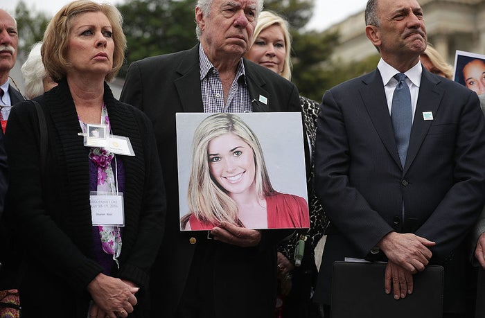 Family members hold pictures of loved ones killed by the opioid epidemic during a news conference on Capitol Hill.