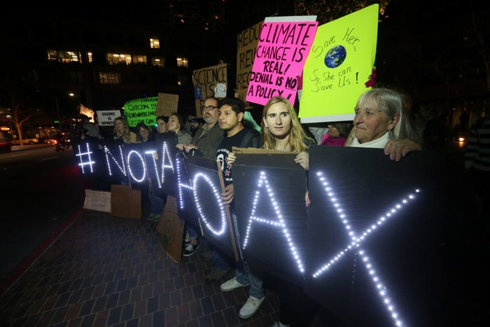 Protesters display lit signs during a rally against climate change in San Diego, California, on Feb. 21, 2017.