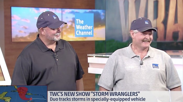 Randy Yarnall, left, and Kelley Williamson discussing storm chasing last year.