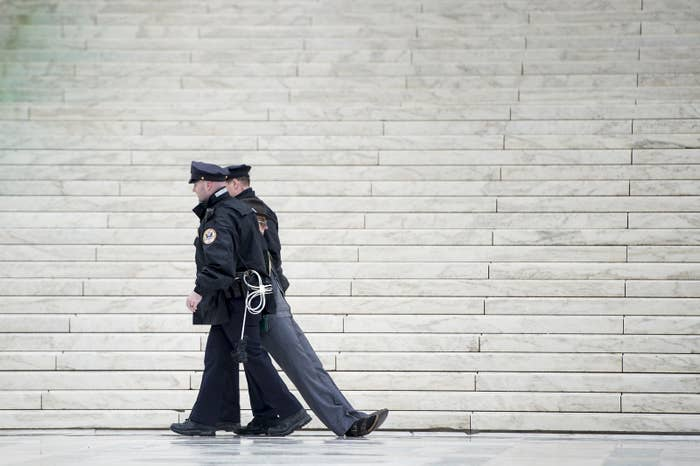 Police officers remove activists during a protest at the US Supreme Court on Jan. 17.