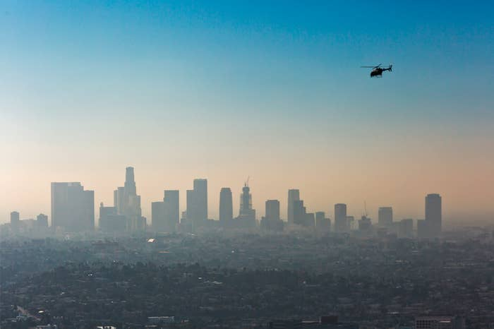 Smog over downtown LA, where smog is often caused by vehicle air pollution. Other more rural parts of the western US have also seen higher smog levels, due to air pollution from Asia, according to scientists.