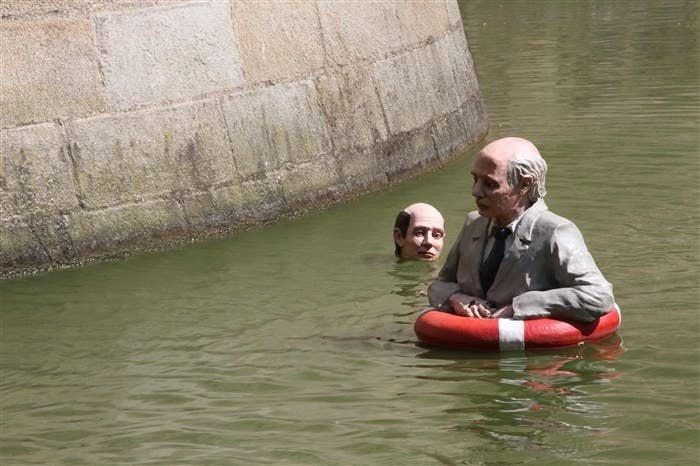 Isaac Cordal is a Spanish street artist that creates sculptures of little men dressed in grey business suits and installs them in unusual places. 'Waiting for the Climate Change' is one of his series that features 14 life-sized sculptures of these everymen submerged in water. His artwork is a critique of modern society's view regarding climate change.Learn more: cementeclipses.com