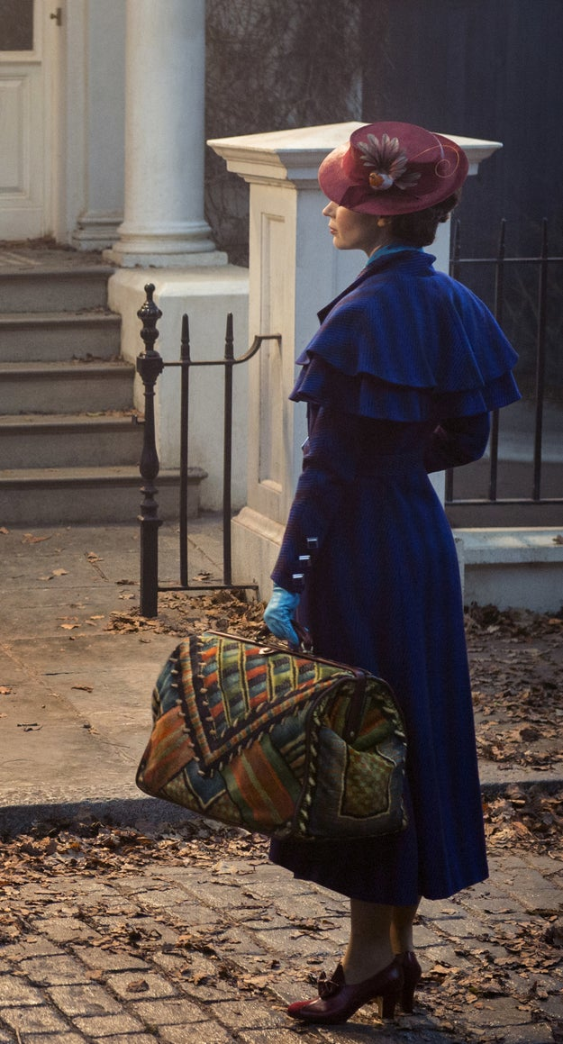Basically, I cannot bear to give you any more context because we got our first look at Blunt in her Poppins costume today and LOOK AT IT:
