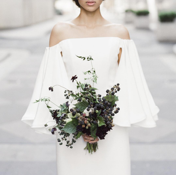 Literally every shirt in stores right now is off-the-shoulder, and the trend has trickled down to wedding dresses, too! Luckily, those dresses can look really stunning, even if you're not Samira Wiley.