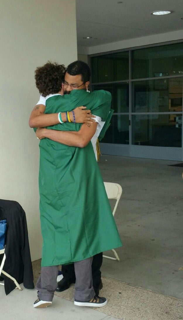 This father, who is suffering from brain tumours, hugging his son at his graduation after being told he would not be able to make it.