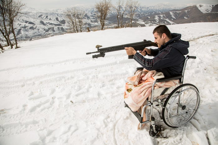 Shirwan Shikho takes target practice near his home.