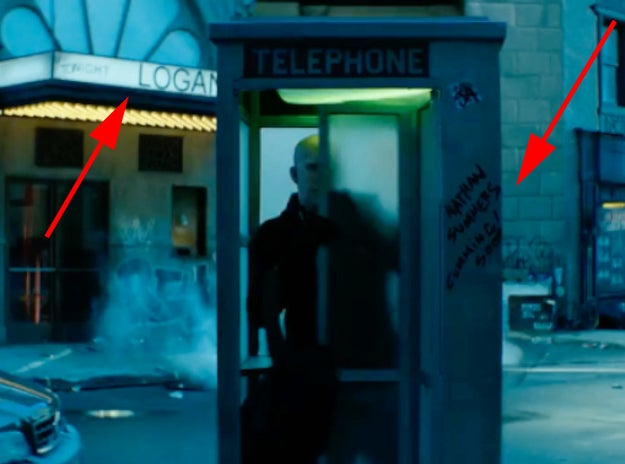 Deadpool races to a nearby telephone booth while the Superman theme music plays so he can change into his disguise.