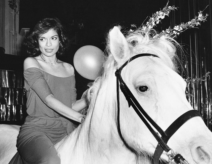 Bianca Jagger rides into Studio 54 on a white horse during her birthday celebrations in 1977.