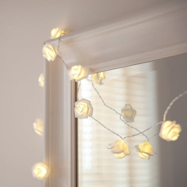 Delicate white rose string lights to create an optimal atmosphere for ~refined lounging~.