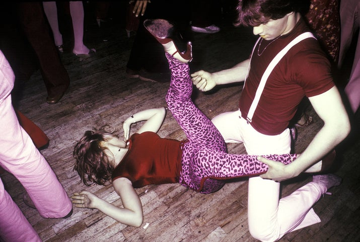 A couple bring their dancing to the floor of the disco club FunHouse in New York City, 1978.