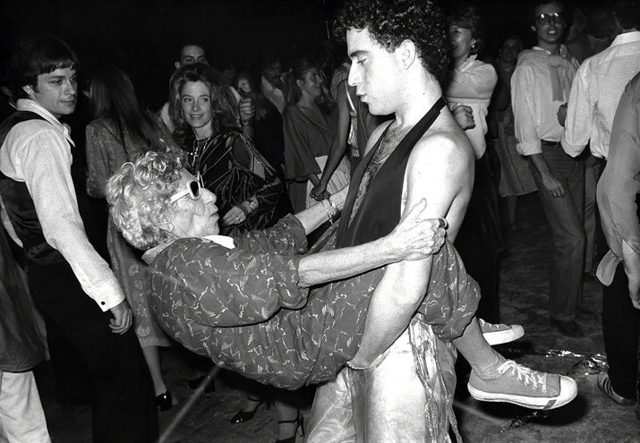 "A woman known as ""Disco Granny"" dances with a young man at Studio 54, circa 1978."