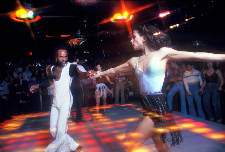 A man and woman take center stage on the dance floor at the disco club 2001 Odyssey in Brooklyn, New York, in 1979.