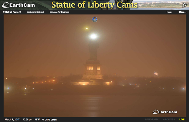 Web cameras that normally show the Liberty Island icon fully illuminated by 10:30 p.m. Tuesday showed only her torch and a handful of other lights.