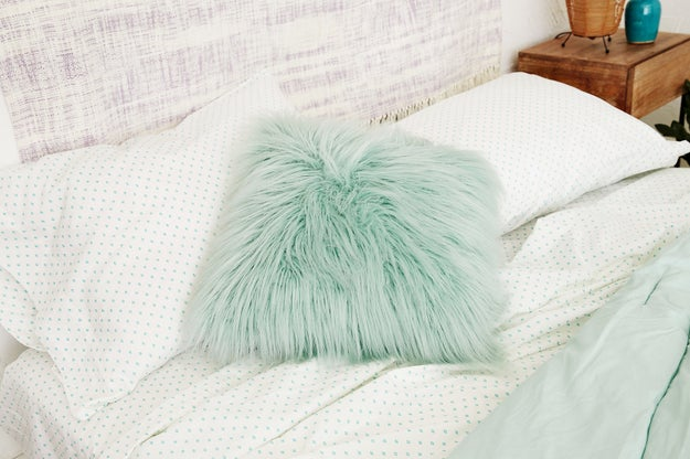 A *wildly* cozy faux lamb fur pillow that softens the room.