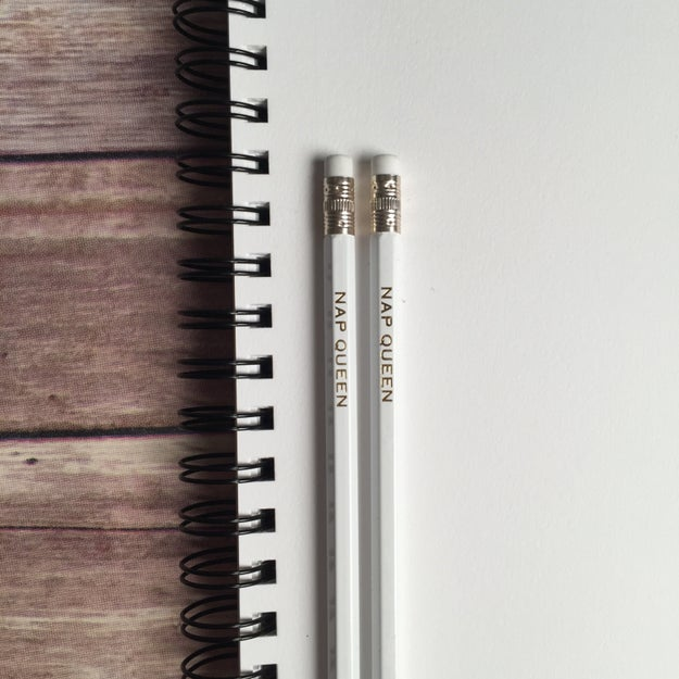 A pair of personalized pencils with your name in gold, like it *should* be.