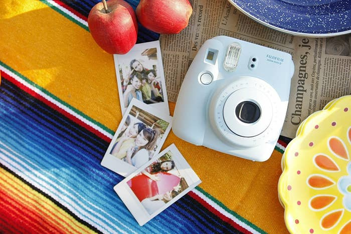 1. An awesome instant camera so they can capture all their memories.