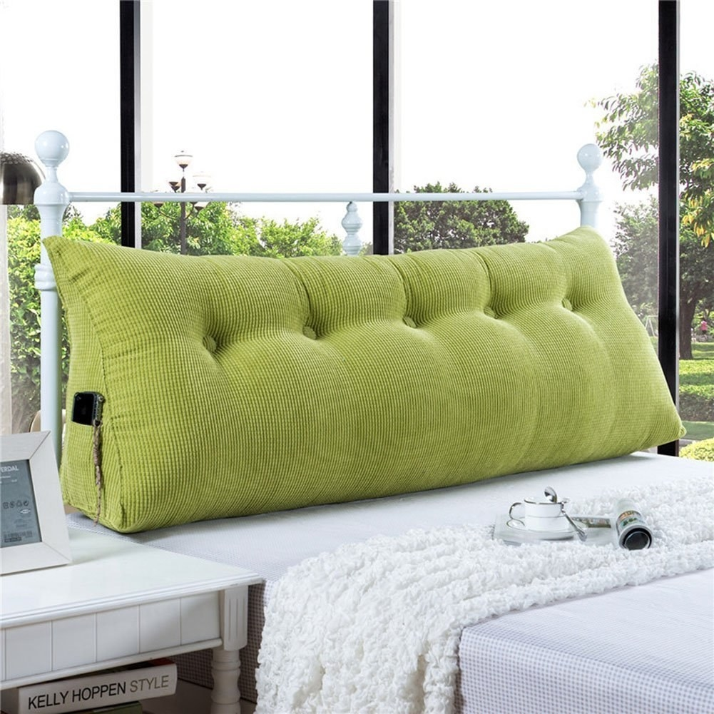 a triangular wedge cushion for anyone who would like to replace their boring old headboard with colorful comfy fluff
