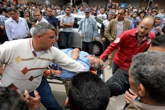 A victim on a stretcher after a bomb went off at a Coptic church in Tanta, Egypt.