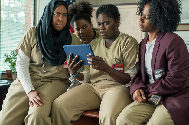 Alison, Cindy, Taystee, and Janae all looking at a tablet.