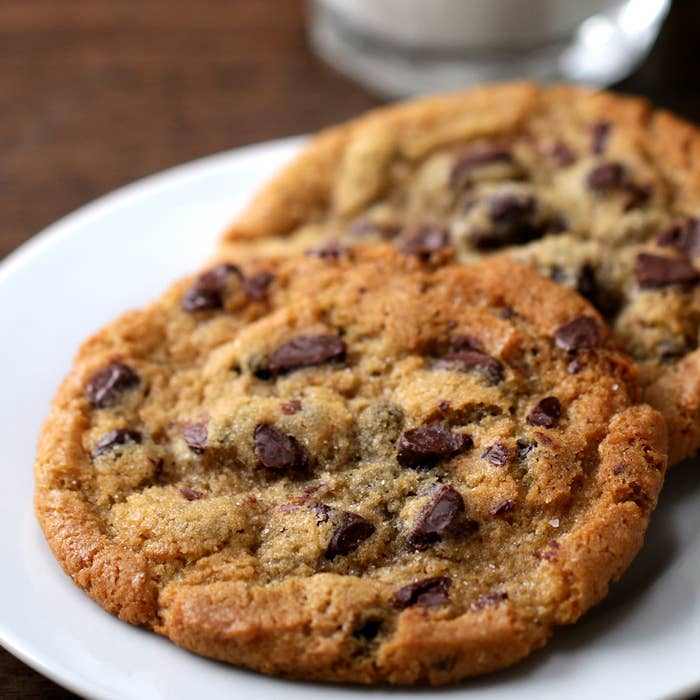 Chocolate Chip CookiesMakes 30 cookiesINGREDIENTS2 cups butter, melted2 cups packed brown sugar 2 cups granulated sugar 4 large eggs1 tablespoon vanilla extract5 cups all-purpose flour2 teaspoons baking soda4 cups chocolate chipsPREPARATION1. Preheat oven to 375°F/190°C.2. In a large bowl, whisk together the butter, brown sugar, and granulated sugar until evenly combined and light in color.3. Add in the eggs and vanilla, mixing until smooth.4. Add the flour and baking soda, folding the mixture until it forms a smooth dough.5. Fold in the chocolate chips until evenly combined.6. Using an ice cream scoop, scoop 6 balls of dough onto a baking tray lined with parchment paper. Bake for 12 minutes, then serve!FOR LATER USE1. To save cookie dough for later use, scoop the dough into balls and place them side-by-side on a baking tray lined with parchment paper.2. Wrap the tray with cling wrap, then freeze for up to one month.3. To bake the frozen dough balls, remove desired number from the tray and bake in a preheated oven for 15 minutes at 375°F/190°C.4. Enjoy!