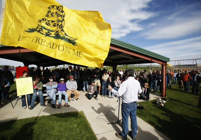 A San Juan County commissioner speaks to protesters in Blanding, Utah, on May 10, 2014.
