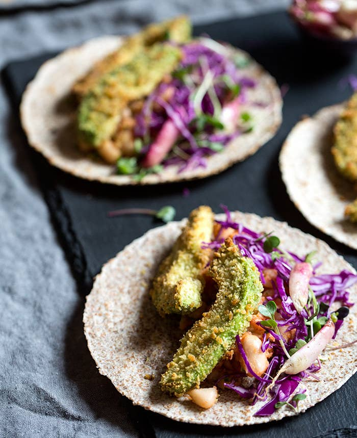 You can never have to many meat-free taco options. These baked and breaded avocados are crispy on the outside but creamy on the inside. Top them with smashed white beans and sriracha and call it a fiesta.