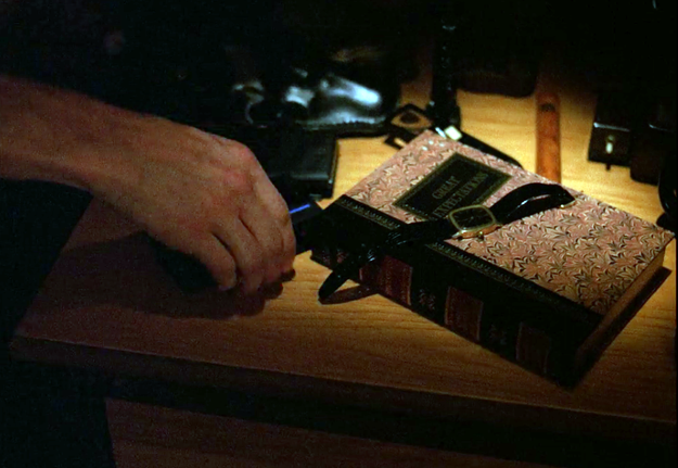 In Episode 6, the book on Cooper's nightstand is Great Expectations by Charles Dickens.