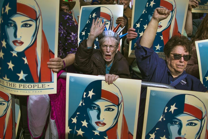 People carry posters during an anti-Trump rally in February.