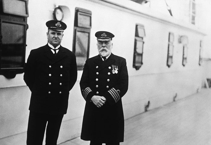 Purser Hugh Walter McElroy and Captain Edward J. Smith aboard the Titanic during the run from Southampton to Queenstown, Ireland. The man who took the photograph, Rev. F.M. Browne, got off at Queenstown, three days before the ship hit an iceberg and sank.