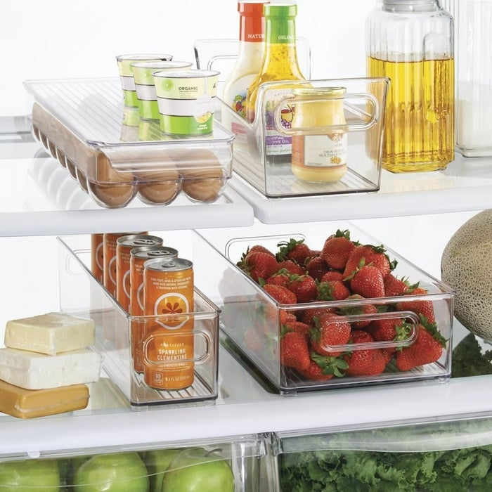 """You don't have to organize everything in your fridge with bins, but this starter set will be a step in the orderly direction. You can pair like with like and prevent spills from rifling through your fridge shelves.Promising Review: """"I have a double-door fridge and in order to fit larger bottles for juice and milk on a shelf, I have to move a shelf up, which creates a very narrow shelf. It was very hard to find things to go on this shelf. With the egg crate and low-profile bin, I was able to create almost a drawer-like setup where I could put yogurt and eggs and just slide out the tray without having to dig to the back."""" --Katie L.Get them from Amazon for $29.99. Includes two bins, a condiment caddy, and an egg holder."""