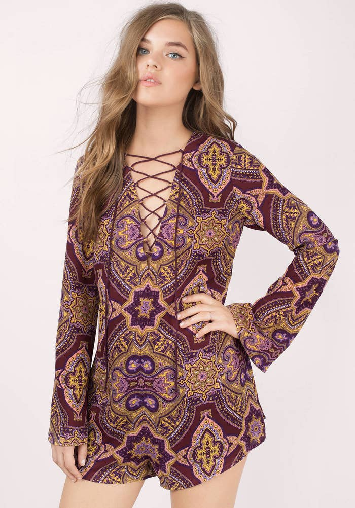 4a1aa03b5265 Make a statement in this stunning wine multi-print romper with a laced up  v-neck. Get it from Tobi ...