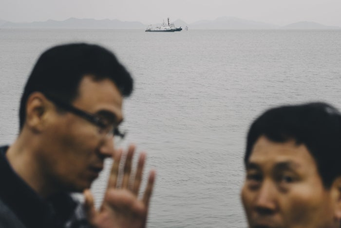 Three days after the sinking, government officials monitor the Paengmok Port, April 19, 2014.