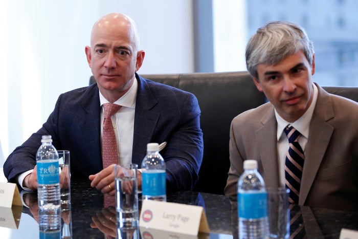 From left: Amazon CEO Jeff Bezos and Larry Page, CEO and cofounder of Alphabet, sit during a meeting with US President-elect Donald Trump and technology leaders at Trump Tower in New York, Dec. 14, 2016.