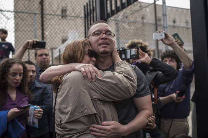 Roberto Almodovar hugs his aunt Mary Rodriguez moments after being released from 23 years behind bars for a murder he didn't commit.